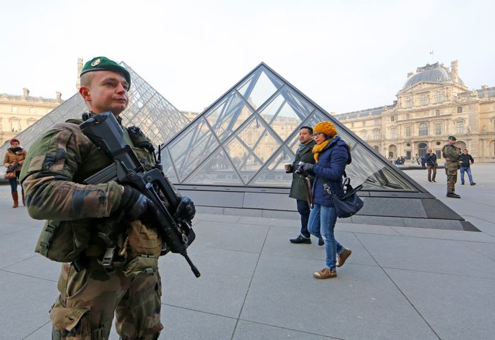 A French soldier wounded a man armed with a machete after he tried to enter the Louvre museum in Paris.