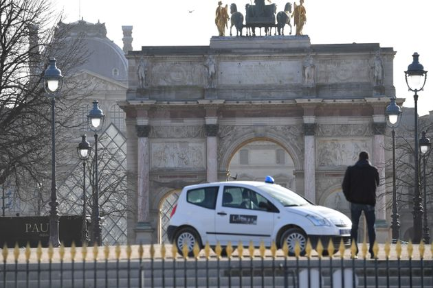 A man stands near the Louvre museum on February 3, 2017 in Paris after a soldier has shot and gravely...