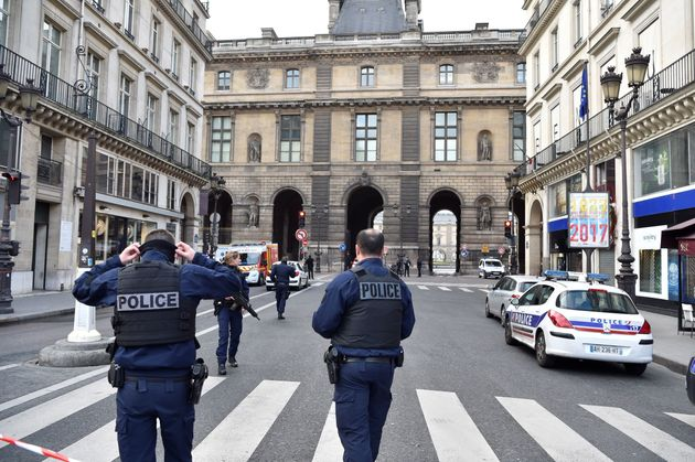 French police officers patrol near the Louvre