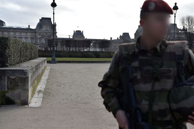 A French soldier stands guard near the
