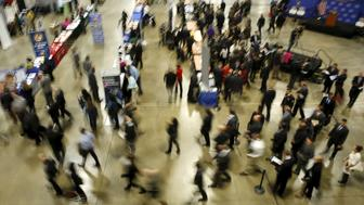 """Job seekers break out to visit corporate employment personnel at a U.S. Chamber of Commerce Foundation """"Hiring Our Heroes"""" military job fair in Washington January 8, 2016. U.S. job growth surged in December and employment for the prior two months was revised sharply higher, suggesting that a recent manufacturing-led slowdown in economic growth would be temporary. Nonfarm payrolls increased by 292,000 last month, the Labor Department said on Friday.     REUTERS/Gary Cameron"""