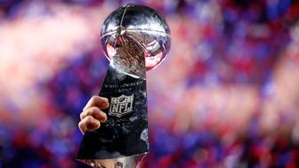 Feb 1, 2015; Glendale, AZ, USA; A member of the New England Patriots hoists the Vince Lombardi Trophy after defeating the Seattle Seahawks in Super Bowl XLIX at University of Phoenix Stadium. Mandatory Credit: Mark J. Rebilas-USA TODAY Sports