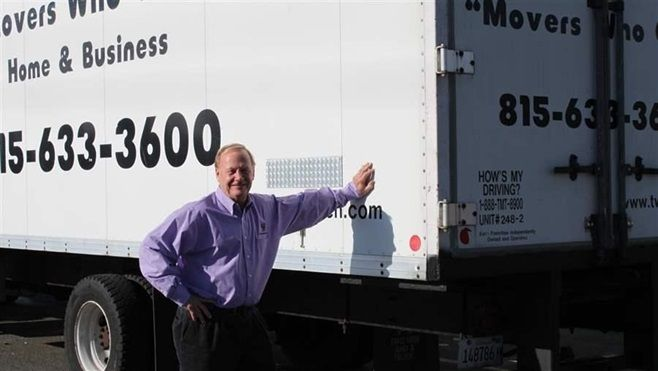 Mover Bob Christensen of Loves Park, Illinois, beside one of his trucks. People moving for jobs or a lower cost of living hel