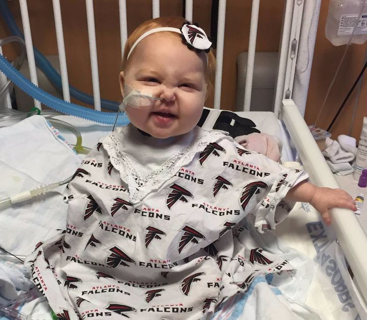Ella's grandmother made her a special Atlanta Falcons-themed hospital gown.