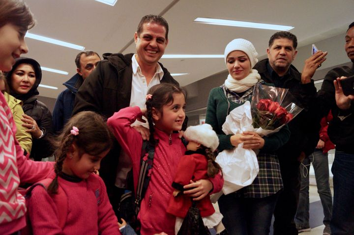 Fadi Kassar is all smiles after being reunited with his daughters Lian, 5, and Hnan, 8, and wife Razan for the first time in