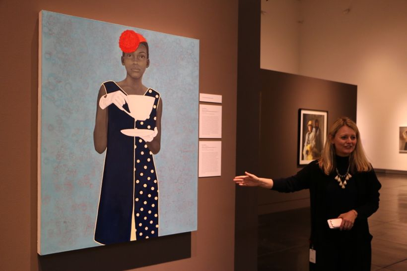 "Dorothy Moss, director of the Outwin Boochever Portrait Competition, shows the first-place-winning  ""Miss Everything (Unsuppr"