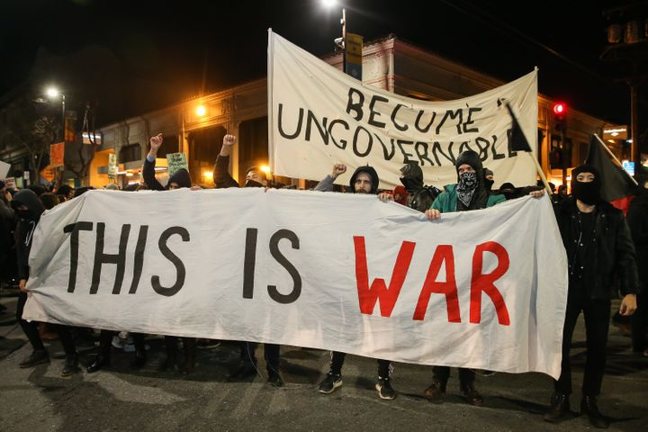 People protesting controversial Breitbart writer Milo Yiannopoulos take to the streets on February 1, 2017 in Berkeley, Calif