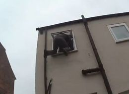 Laughing Policemen Photograph Man Stuck In Window Of House He Was Trying Burgle