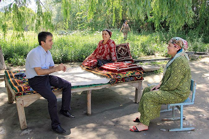 Amir Madamoniv, UN Women Programme Coordinator, meets with women living along the Tajik-Kyrgyz border. Photo: UN Women/Aijam