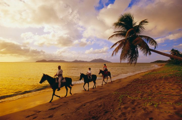 Horseback riding on Pinney's Beach