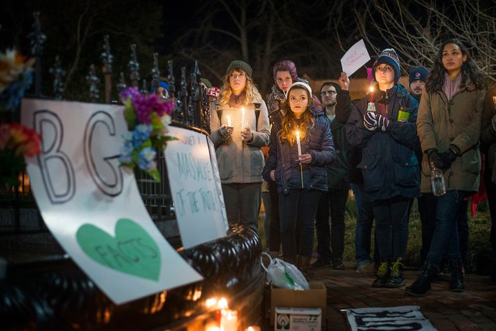 Community members hold candles at the Bowling Green Massacre Remembrance Gathering Feb. 3, 2017. Organizer Justin Swindle, 27