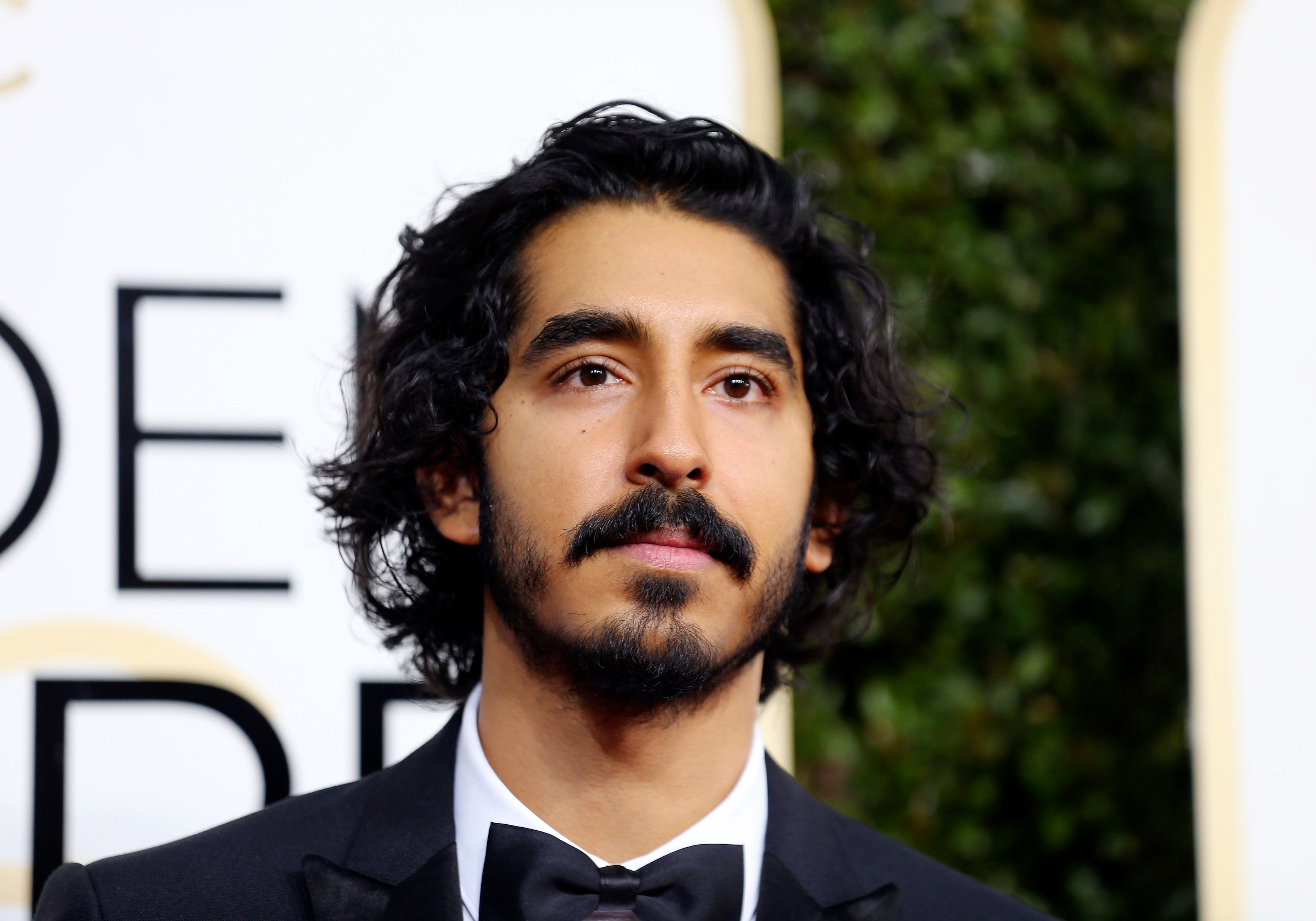 Oscar nominee Dev Patel has told of the 'nightmare' of flying into the US after Donald Trump's travel