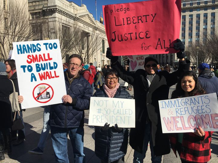 From left to right: Jonand Diana Sokolow, TomSmith and Christina Dawson protest Trump's travel ban outside the Wh
