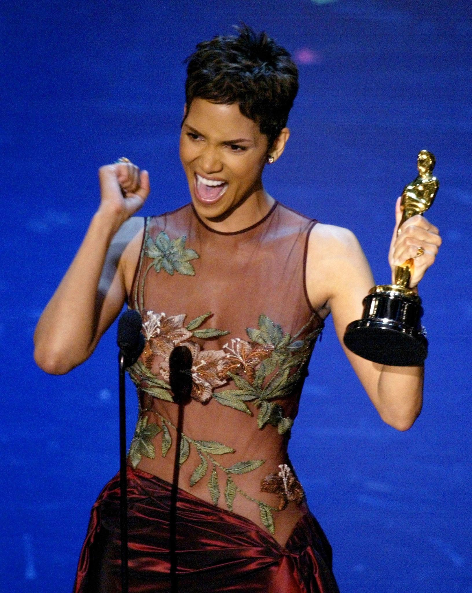 Halle Berry reacts to winning the Oscar for Best Actress during the 74th annual Academy Awards.