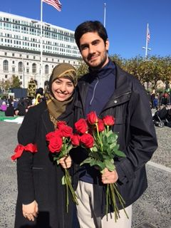 Hamideh and Amin at the annual commemoration of Ashura in Civic Square, San Francisco, where they pass out red roses symboliz