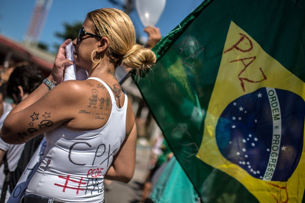 Protesters calling for peace and an end to police violence protest in Rio de Janeiro's Alemao favelas in 2015.