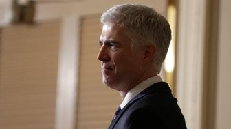 Supreme Court Nominee Judge Neil Gorsuch watches as Chairman of the Senate Judiciary Committee Chuck Grassley (R-IA) speaks to the media on Capitol Hill in Washington, U.S., February 1, 2017.      REUTERS/Joshua Roberts