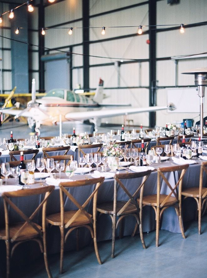 Airplane hanger wedding, Livermore, California. Captured by Kristine Herman Photography