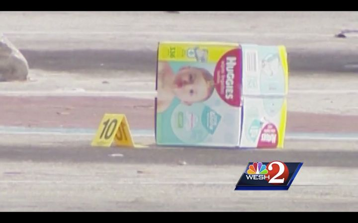 A box of diapers rests in the parking lot of a Florida Walmart after an alleged shoplifting incident turned deadly.