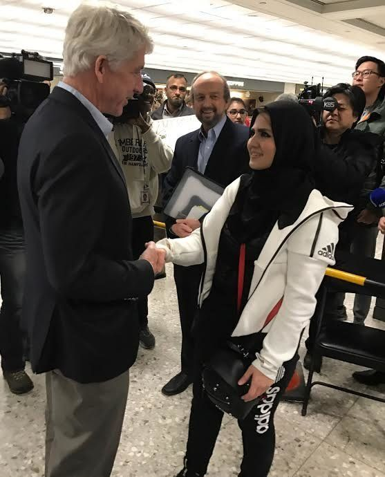 Virginia Attorney General Mark Herring welcomes George Mason University student Najwa Elyazgi, 23, upon her return to the U.S