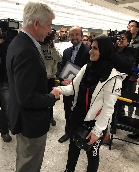 Virginia Attorney General Mark Herring welcomes George Mason University student Najwa Elyazgi, 23, upon her return to the U.S