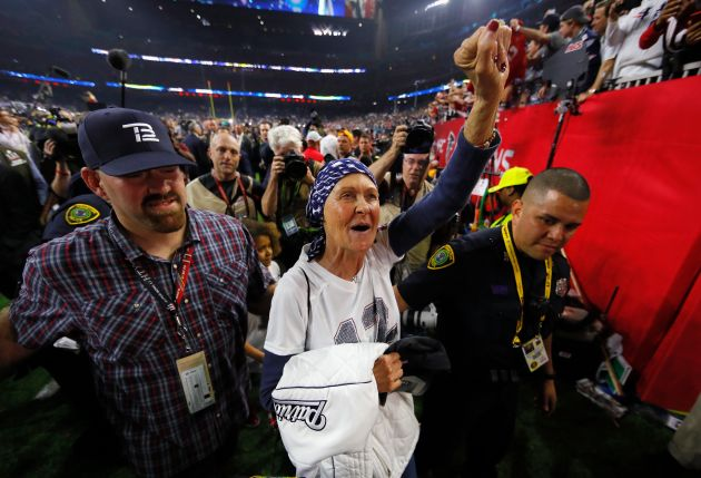 Galynn Brady leaves the field followingthe New England Patriots' victory at the Super Bowl