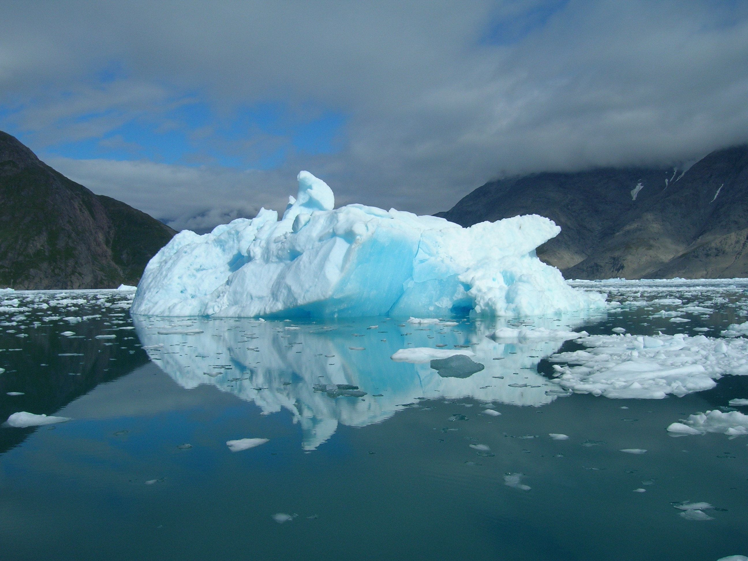 Iceberg floating in the sea at the coast of Greenland a beautiful summer day.
