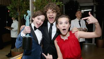 WEST HOLLYWOOD, CA - JANUARY 29: (L-R) Actors Noah Schnapp, Gaten Matarazzo and Millie Bobby Brown attend The Weinstein Company & Netflix's 2017 SAG After Party in partnership with Absolut Elyx at Sunset Tower Hotel on January 29, 2017 in West Hollywood, California. (Photo by Phillip Faraone/Getty Images for The Weinstein Company/Netflix)