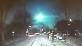 A fireball is seen zipping across the early morning sky