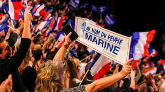 People cheer as Marine Le Pen, French National Front (FN) political party leader and candidate for the French 2017 presidential election, attends the 2-day FN political rally to launch the presidential campaign in Lyon, France February 5, 2017. REUTERS//Robert Pratta