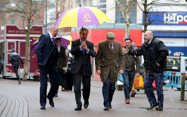 Paul Nuttall and former Ukip leader Nigel Farage dodge an egg thrown at them while campaigning in