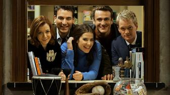 CBS's new comedy, 'How I Met Your Mother,' is one of this season's hits and for CBS a breakthrough into comedy aimed at younger people, a la Friends–style. The half–hour sitcom is taped on a stage with four cameras like a regular sitcom – but without the audience, & with many more takes, like dramas. Thereason for that is that the scripts, which are told in flashback, are much longer than regular sitcom scripts & the storytelling is a big part of the show, which can't be done in front of an audience. Because of their isolated tapings, the cast has grown very close and critics have said, this could be the next Friends cast in terms of togetherness and chemistry. – The cast, photographed on the set on 11/9/05 is: Alyson Hannigan, Josh Radnor, Cobie Smulders, Jason Segal, and Neil Patrick Harris.  (Photo by Gary Friedman/Los Angeles Times via Getty Images)