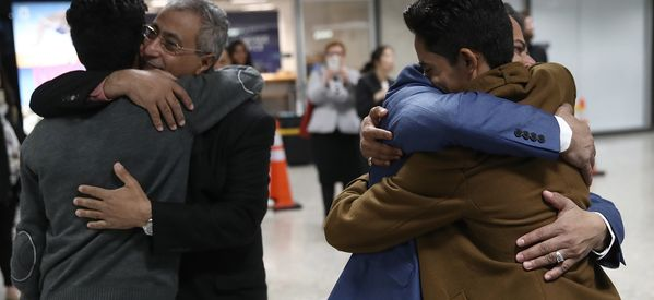 Ping-Ponging Between Continents And From Hope To Despair, 2 Families Finally Arrive In U.S.