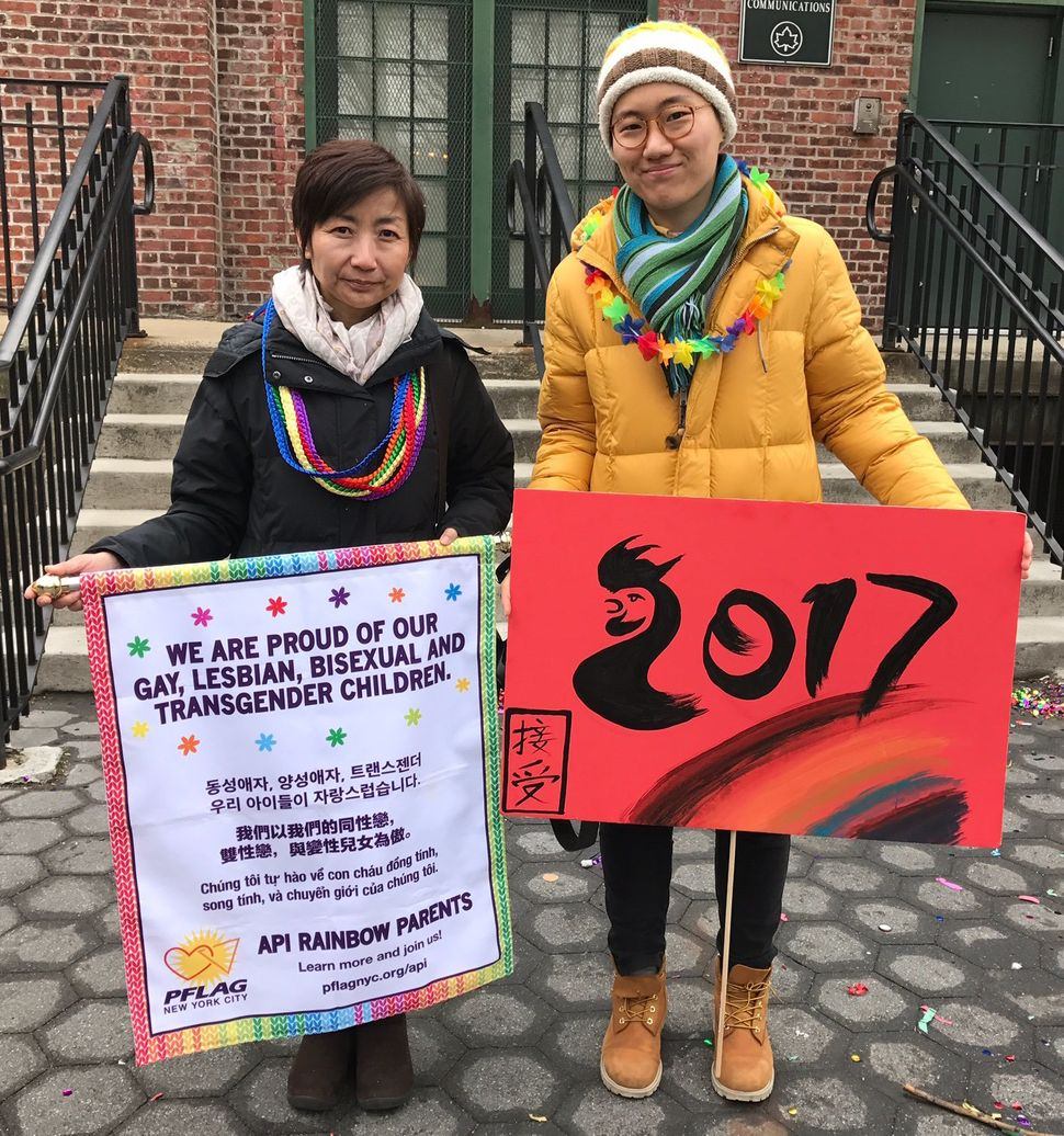 Clara Yoon and Lanny Li march with LGTBQ Asian-Americans in the Lunar New Year parade to highlight the unique issues the