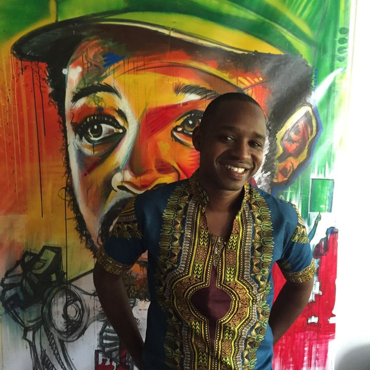 Boniface Mwangi stands in front of a work of art in PAWA254, an art space founded in Nairobi's Central Business District in 2