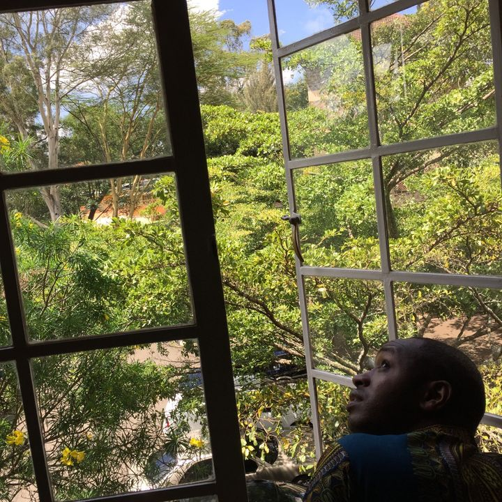 Boniface Mwangi looks out a window in his office at PAWA 254, an arts and activism space in Nairobi, Kenya.