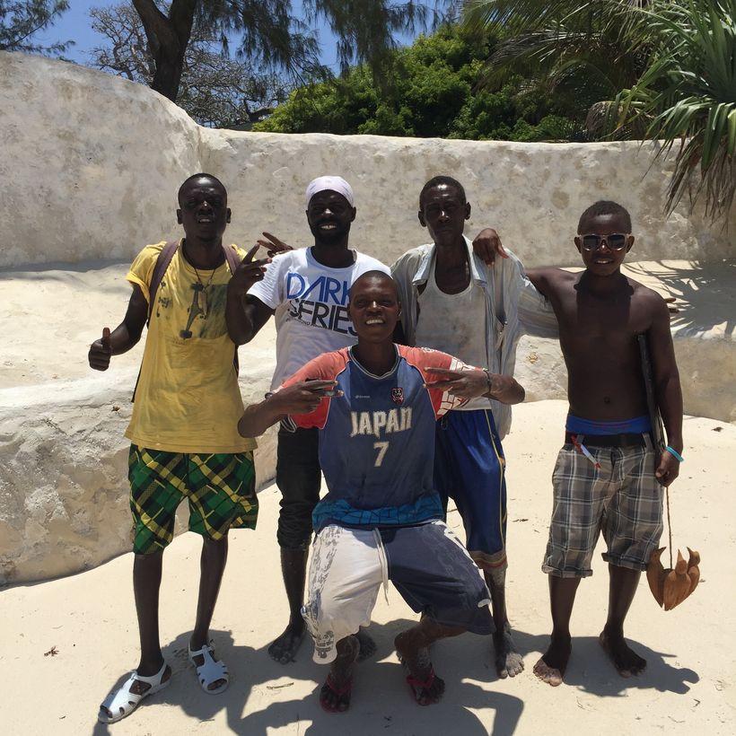 Five Sea Safari crew members pose for a group photo in Diani Beach, Kenya.