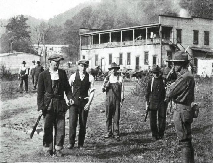 Blair Mountain strikers give up their guns after battle