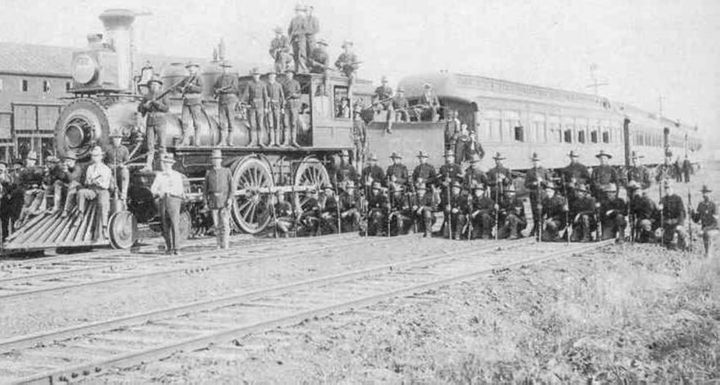 Federal troops guard a train near the Pullman factory