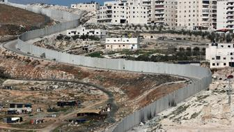 A picture taken on February 6, 2017 shows Israel's controversial separation barrier dividing east Jerusalem (L) from the West Bank village of Anata (R). / AFP / THOMAS COEX        (Photo credit should read THOMAS COEX/AFP/Getty Images)