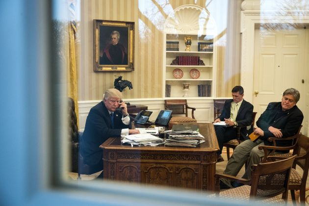 President Donald Trump speaks on the phone with Australian Prime Minister Malcolm Turnbull on Jan. 28, 2017, with national security adviser Mike Flynn, center, and Chief Strategist Steve Bannon, at right.