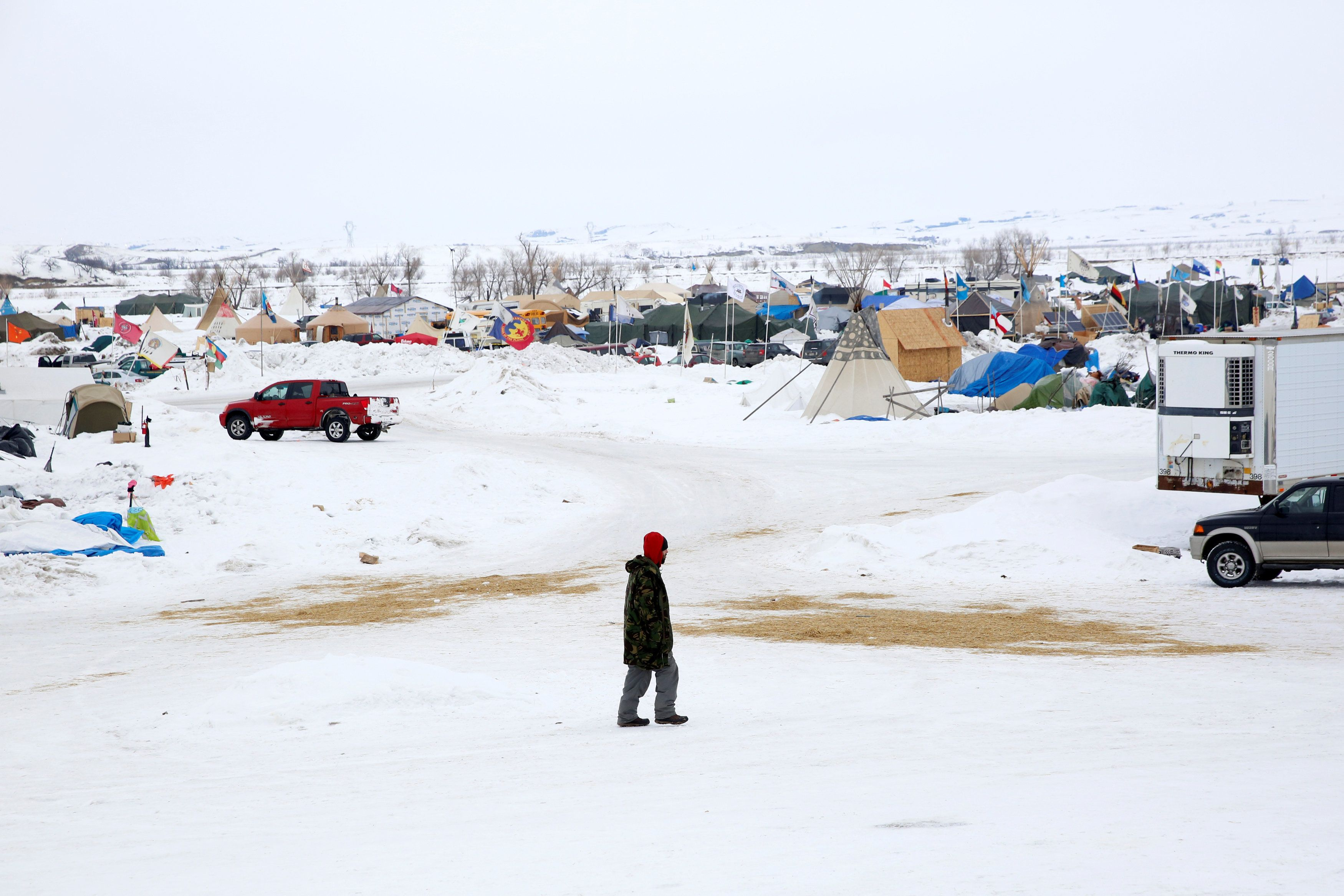 A man walks through the Dakota Access Pipeline protest camp on the edge of the Standing Rock Sioux Reservation near Cannon Ball, North Dakota, U.S., January 24, 2017. REUTERS/Terray Sylvester     TPX IMAGES OF THE DAY