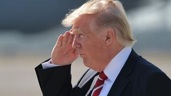 US President Donald Trump salutes upon arrival at MacDill Air Force Base on February 6, 2017 in Tampa, Florida to visit the US Central Command and Specials Operations Command.  Trump on Monday paid his first visit to US Central Command, meeting officers who will form the tip of the spear in implementing his new strategy to defeat the Islamic State group. / AFP / MANDEL NGAN        (Photo credit should read MANDEL NGAN/AFP/Getty Images)