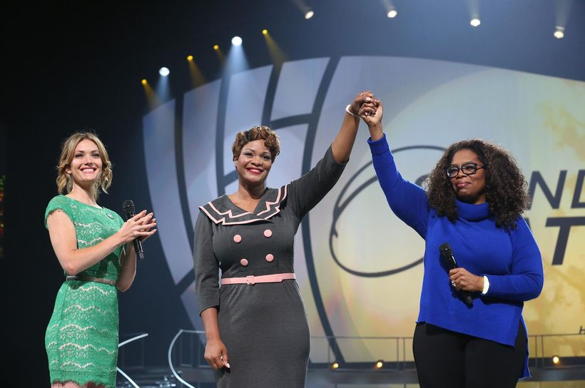 Army Reserve Maj. Jas Boothe receives the Standing O-Vation award from Oprah Winfrey and Toyota in 2014.