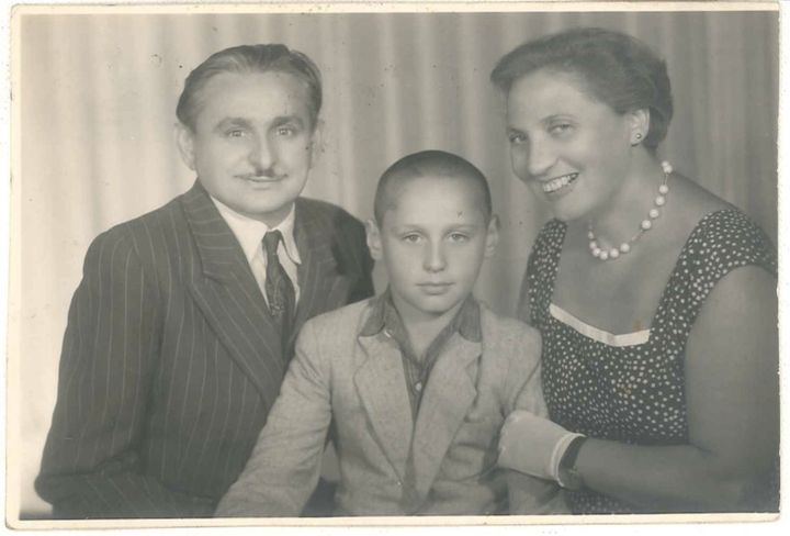 Alex with his father, Moses, and his mother, Sabine, about a year before the Kozinskis left Romania.