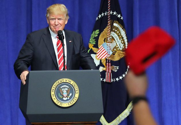 Donald Trump is welcomed as he speaks to commanders and coalition representatives during a visit to U.S....