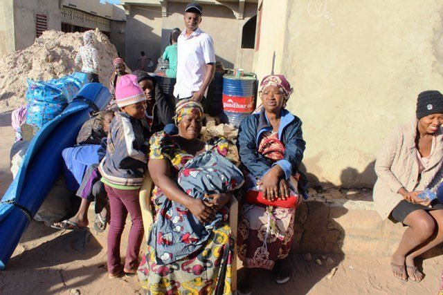 The morning after outgoing President Jammeh left Gambia, this family of women and children await the bus to Banjul.
