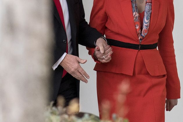 May was photographed holding Trump's hands while walking down the White House Colonnade in