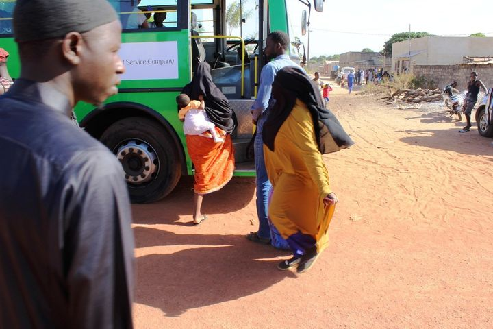 Buses dispatched by the Gambian government arrive at the refugee camp in Karang, Senegal; 70 percent of the returnees were wo