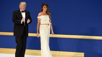 US President Donald Trump and First Lady Melania Trump during the Salute to Our Armed Services Inaugural Ball at the National Building Museum in Washington, DC, January 20, 2017. / AFP / SAUL LOEB        (Photo credit should read SAUL LOEB/AFP/Getty Images)